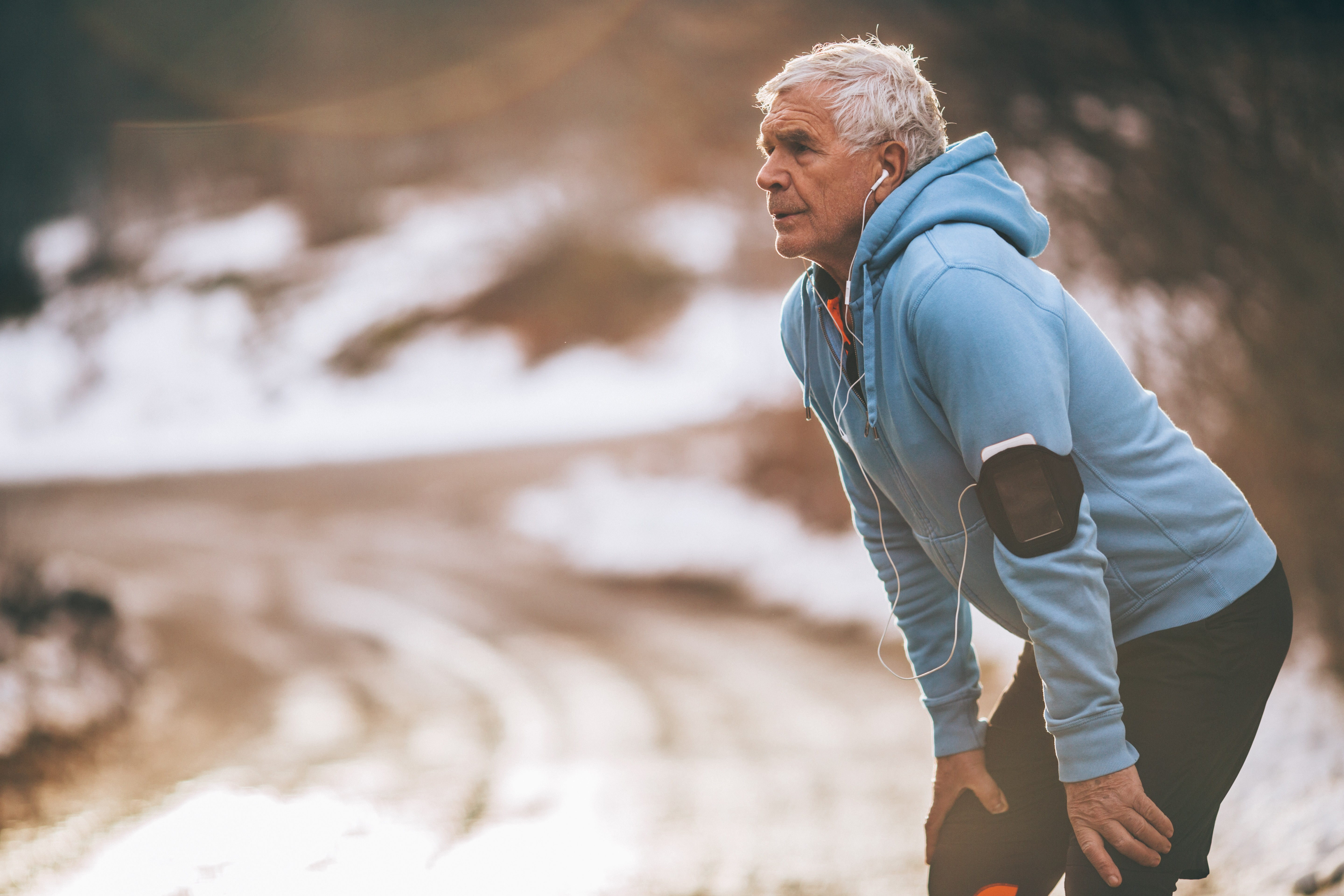 An older man exercising in the winter