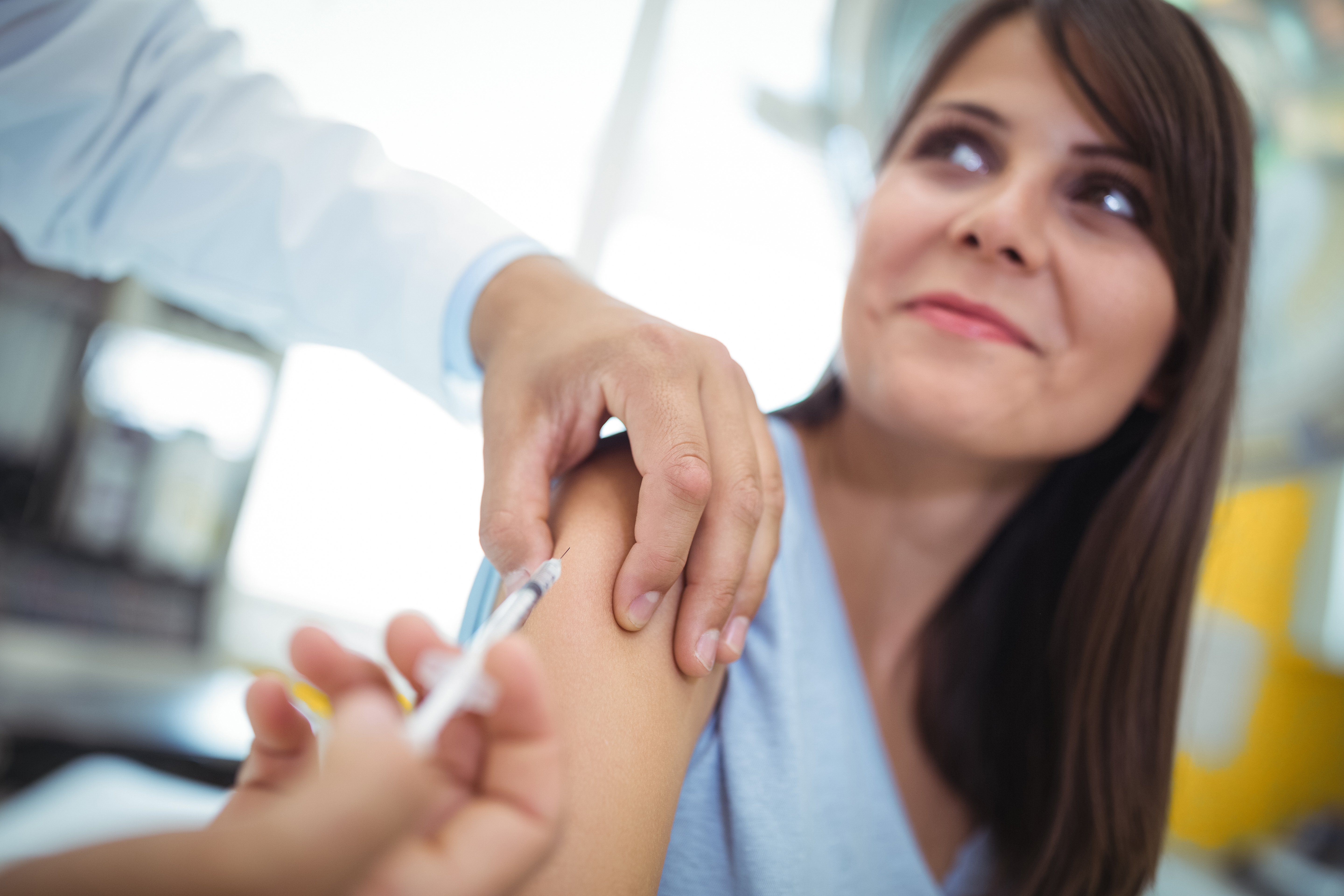 A woman receiving a flu shot