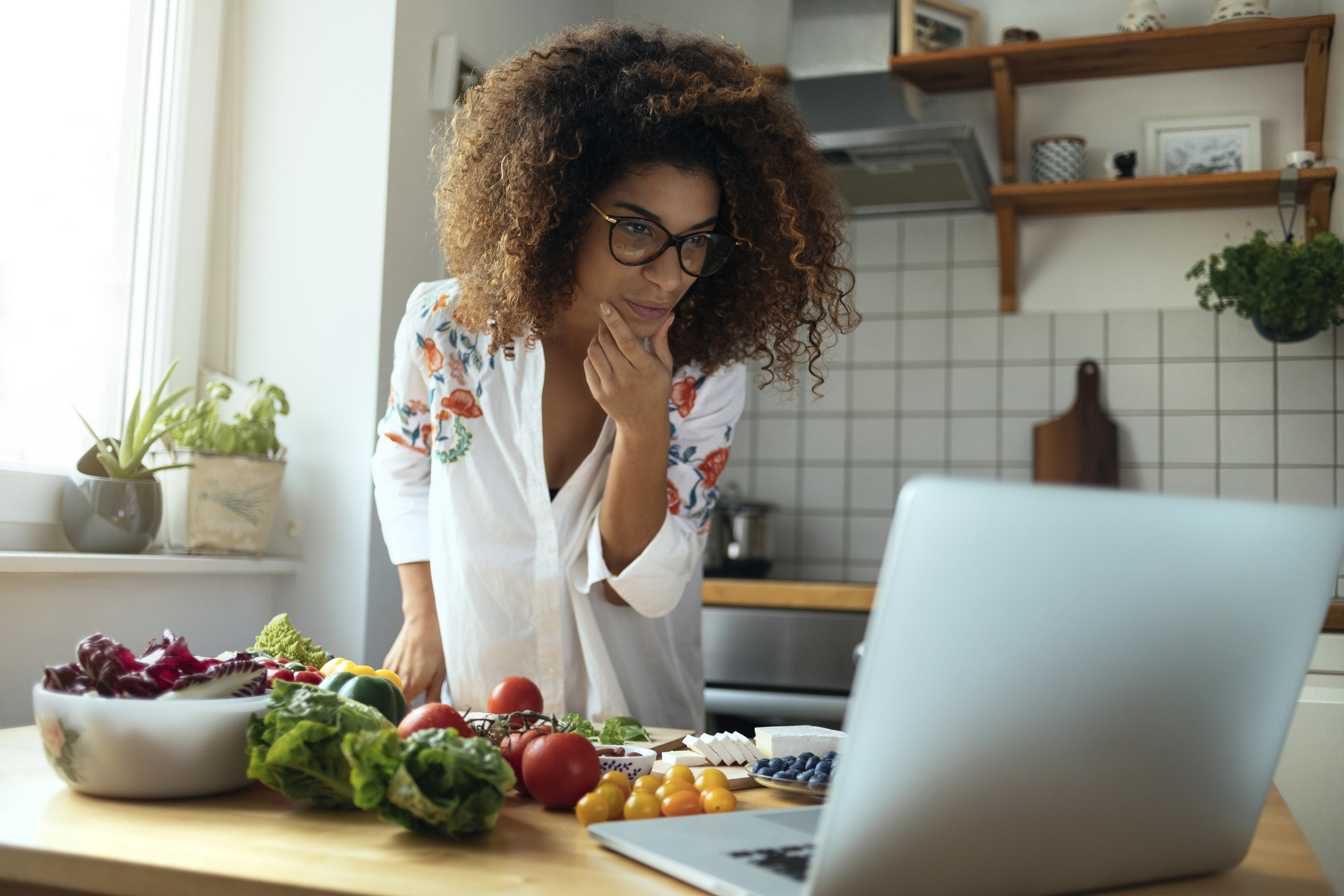 A woman looking at healthy recipes online