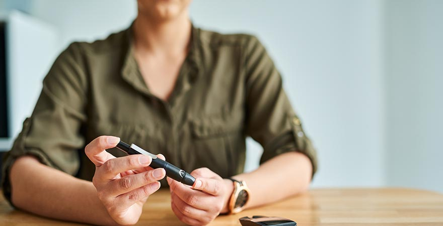 A woman checking her glucose levels