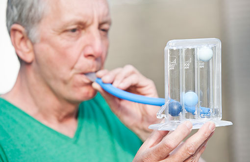 a man performing a pulmonary function test