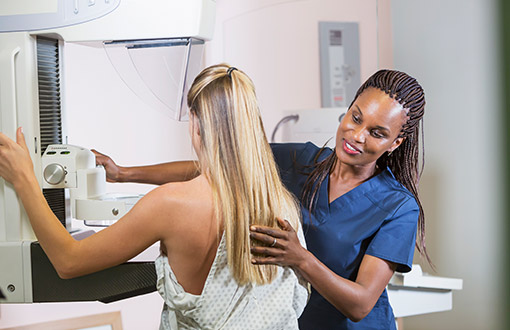 A woman receiving her mammogram