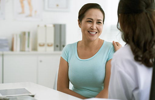 A woman talking to her doctor about a mammogram