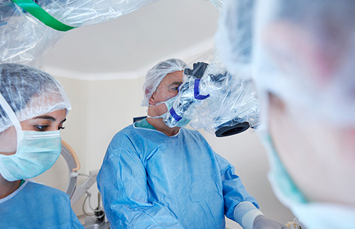 A doctor performing a minimally invasive surgery