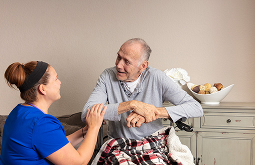 A nurse helping a hospice patient