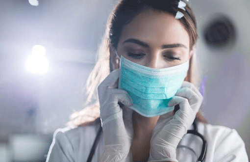 An RN with a surgical mask